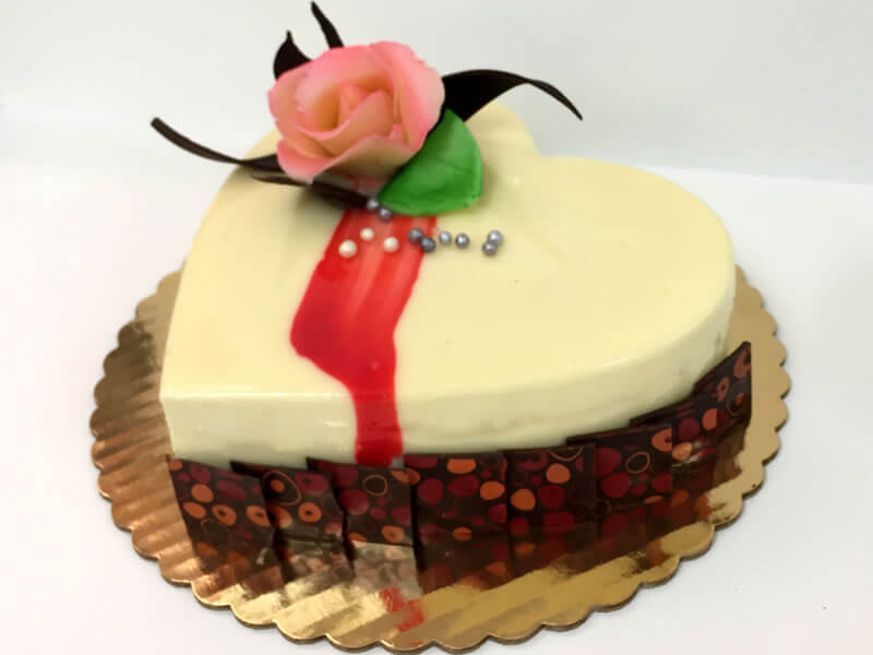 White chocolate raspberry heart cake